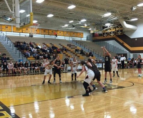 Apple Valley sophomore forward Marie Olson shoots a free throw during the first half of Tuesday's game against Farmington