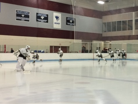 Apple Valley girls begin to warm up before the second period, Tuesday night.