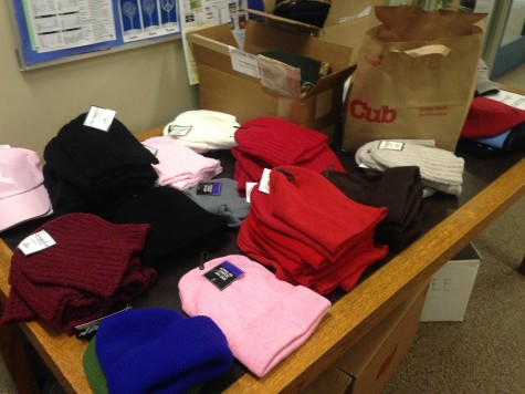 Donated hats at a table in the main office.