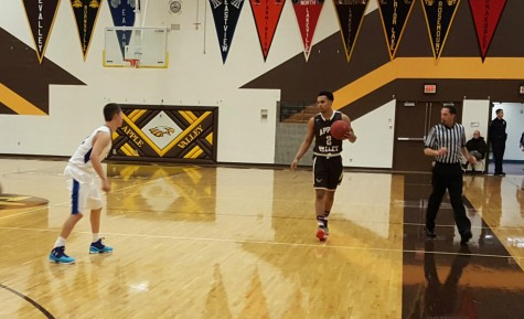 Apple Valley's Gary Trent, Jr. looks to make a play against Eastview on Friday night.