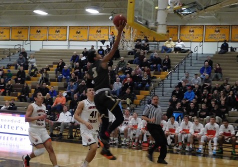 Eagles' guard Tre Jones drives to the basket after coming off the fast break