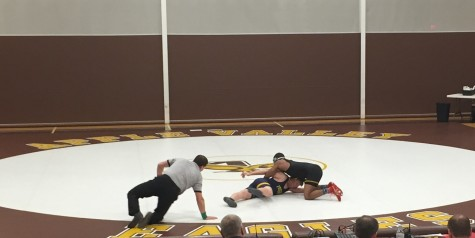 Senior captain Mark Hall takes down his opponent in his match Friday night.