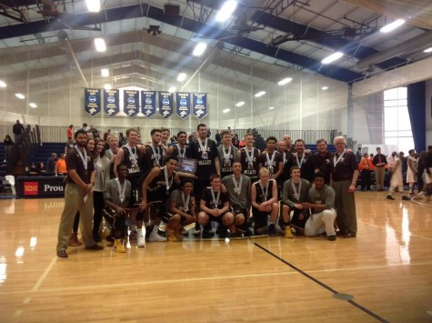 The Eagles pose for a picture with their third place trophy.