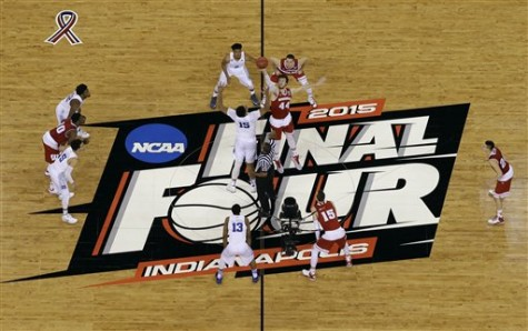 Duke's Jahlil Okafor (15) and Wisconsin's Frank Kaminsky (44) battle for the ball at the tip off during the first half of the NCAA Final Four college basketball tournament championship game Monday, April 6, 2015, in Indianapolis.
