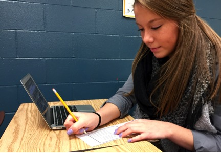 Senior Kathrine Groh takes a test in AP Calc