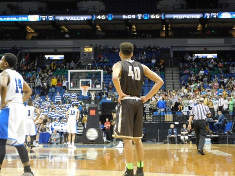 Cameron Kirksey looks on as Hopkins attempts a free throw.