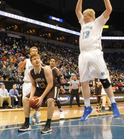 Apple Valley forward Aaron Ertz attempts to draw a foul against Blaine
