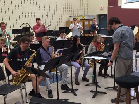 Mr. Scalise rehearses with band students after school.