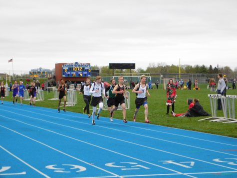 From right to left: Eagles George Knier, Patrick Erredge and Kyle Steinberg finish up the 800 meter race.