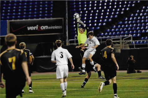 Tim Van Beck going up for a save. Van Beck holds school records for save percentage and career shutouts.