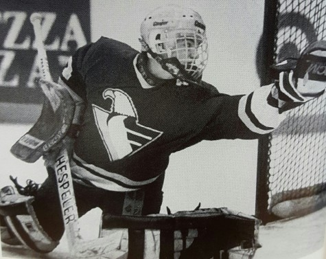 Apple Valley goaltender Karl Goehring makes a glove save in a state tournament game (Photo via Apple Valley yearbook)