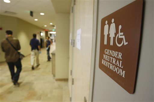 In this Aug. 23, 2007 file photo, a sign marks the entrance to a gender neutral restroom  at the University of Vermont in Burlington, Vt. For opponents of transgender rights, a favorite line of attack is to oppose policies that would allow people to choose whether to use a men's or women's bathroom based on gender identity.