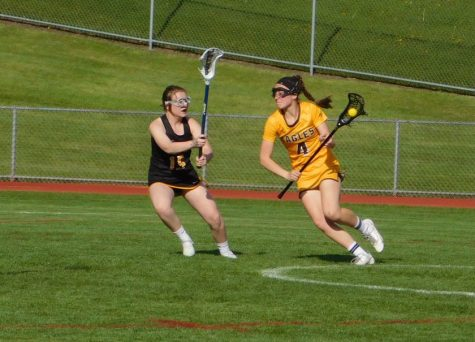 Captain Katie Moynihan drives to the net. She finished the game with five goals.