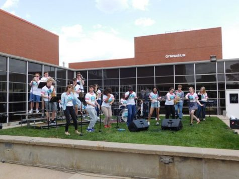 The R&B band rocks out in the courtyard after school.