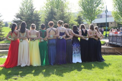 A group of girls and their colorful dresses.