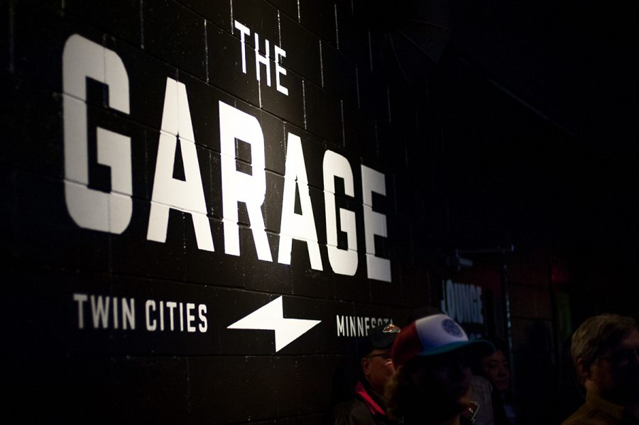 The Garage's logo on a wall near the stage.