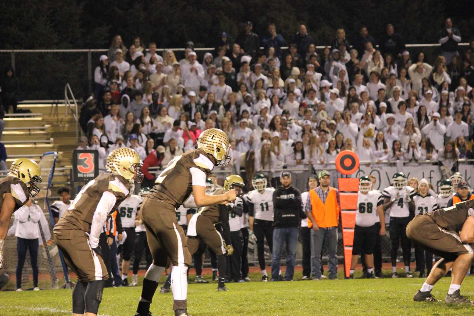 Noah Sanders prepares to receive the snap as the Park High School student section looks on.