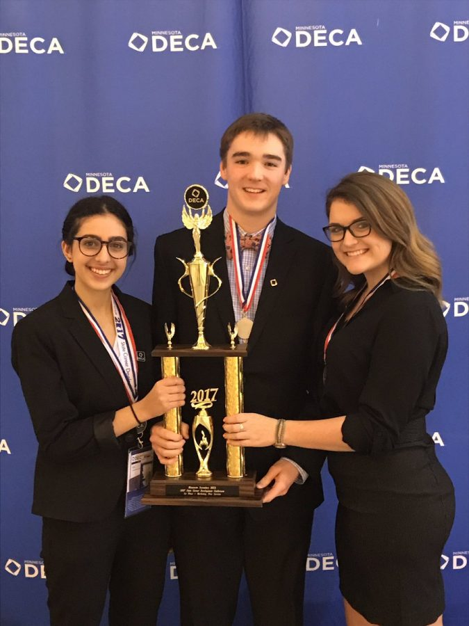 Tayla Rawdah, Ford Dreidel, and Carleen Olson proudly displaying their Marketing Plan-Services trophy