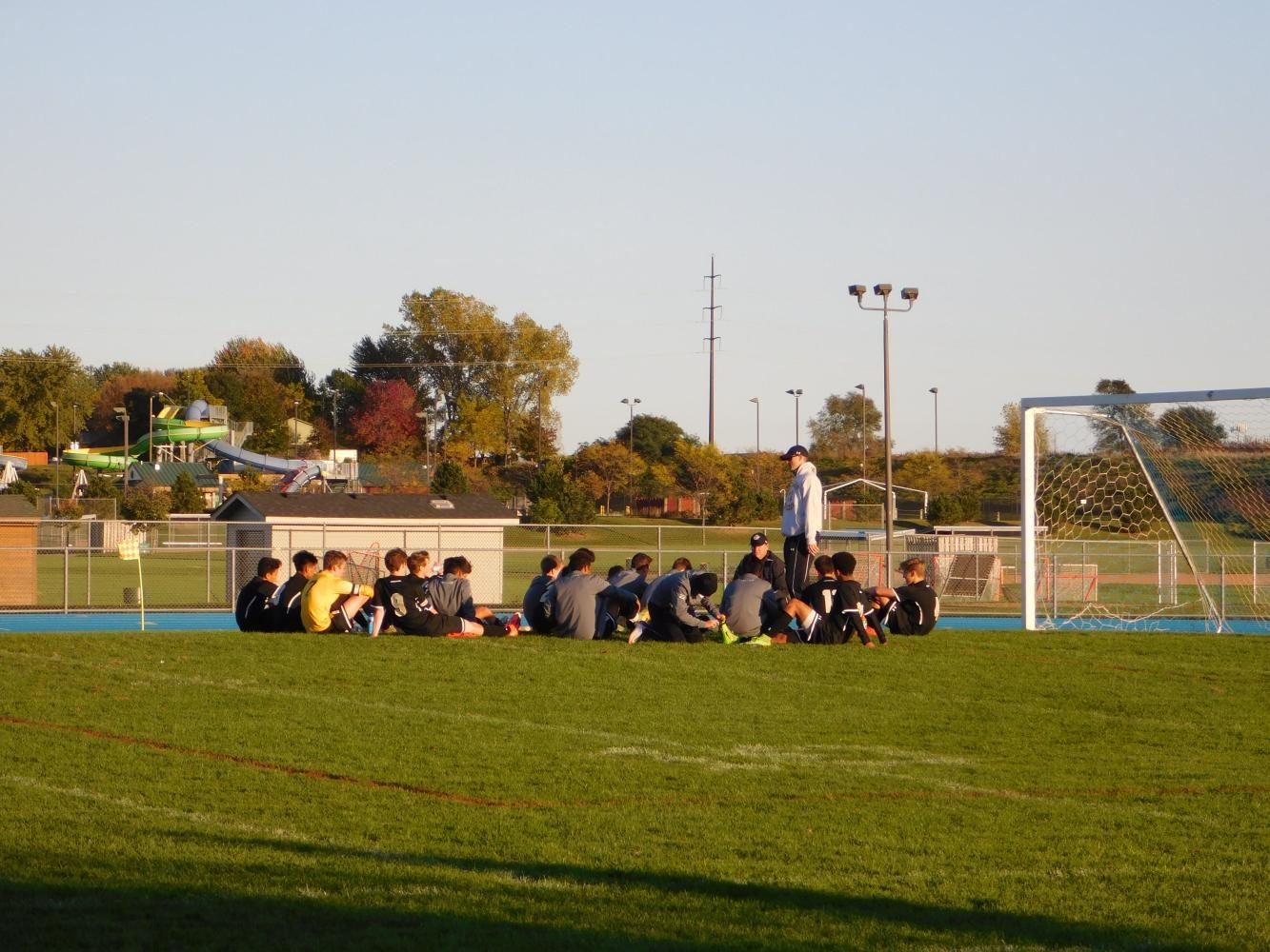 The team soaks in the sun and the play plans.