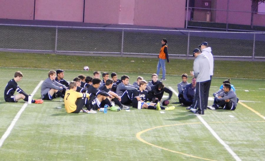 The boys gather for words of wisdom of the coaches.