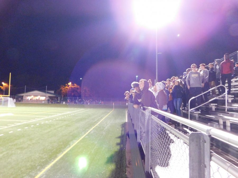 Many fans stayed after the sun set to support the team.