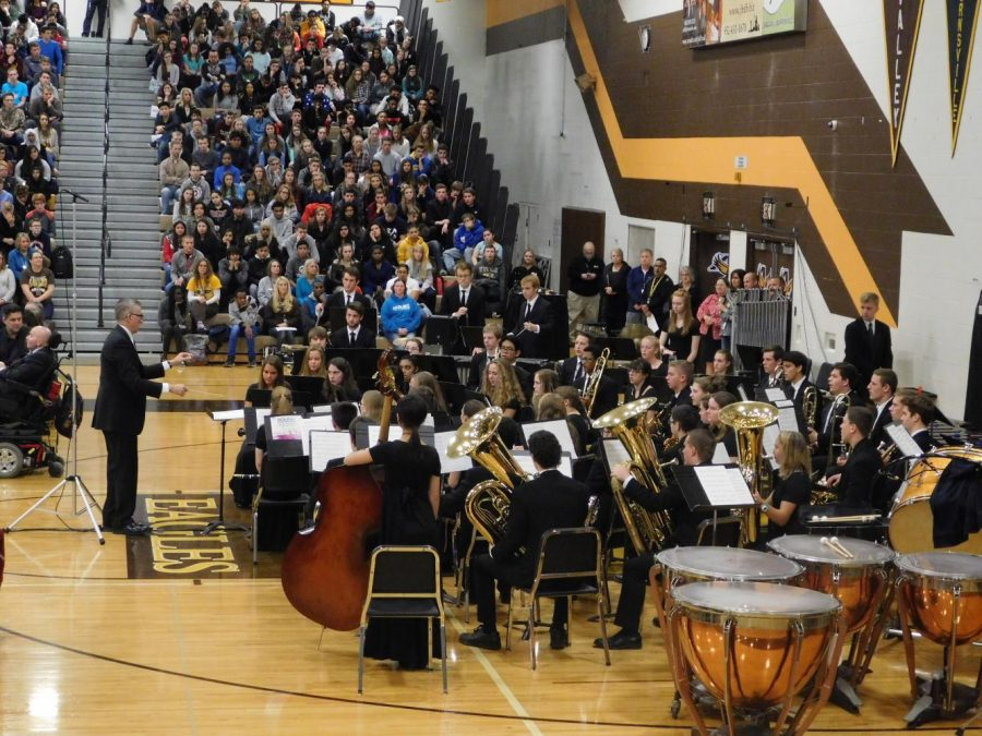 Corey Desens directs AVHS Wind Ensemble in their performance of