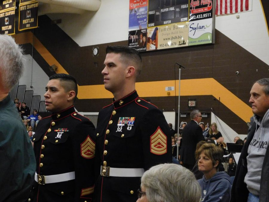 Veterans stand as they hear their theme song from the
