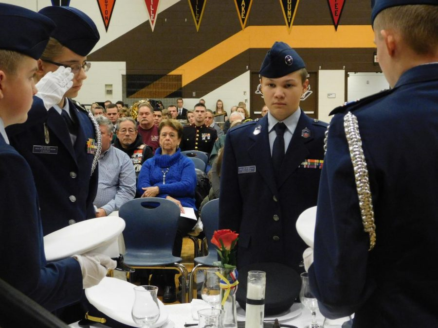 Members of JROTC perform the Table of Remembrance ceremony.