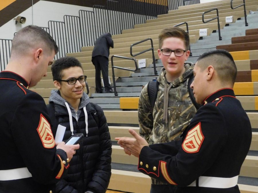 AVHS students talking with members of the armed forces.