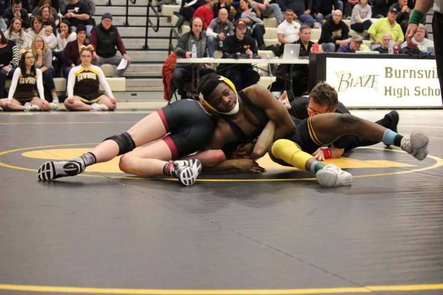 Senior Martin Stewart controls Simon Kajer of New Prague in a semifinal dual.