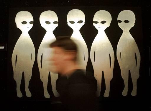 A patron passes a painting inside the International UFO Museum and Research Center in Roswell, N.M., Tuesday, June 10, 1997. The small town is bracing for its biggest invasion yet, the 50th anniverary of an alleged UFO crash.