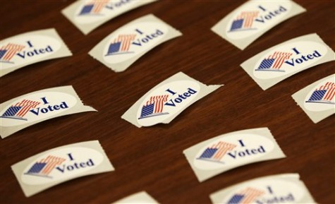 I Voted stickers sit on a table during early voting for the Nov. 6th election, Wednesday, Oct. 24, 2012, at the Davenport Public Library in Davenport, Iowa. Early voting for the Nov. 6th election likely will set an Iowa record, as presidential candidates seek to lock-in votes in the battleground state. (AP Photo/Charlie Neibergall)