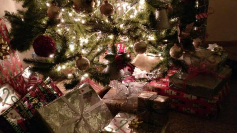 Perfectly wrapped presents stack up under the tree as the days til Christmas dwindle down.