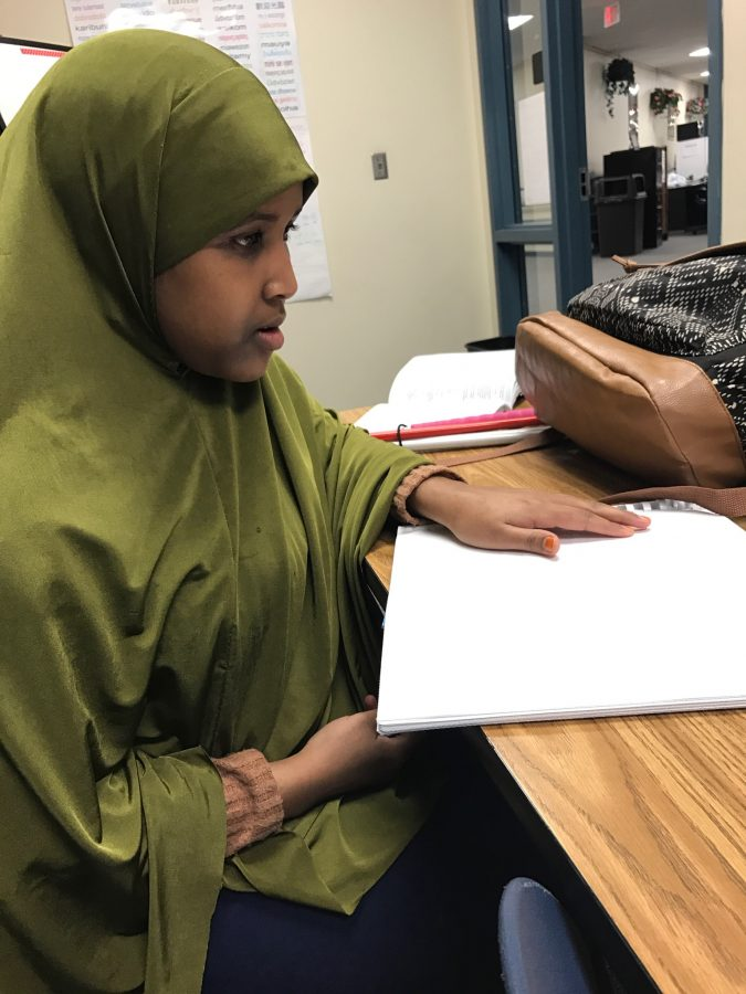 Naima loves reading and studying her school  textbooks such as u.s. history, which you see above.