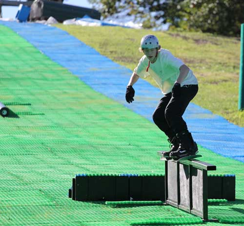 Snowboarder trying out Buck Hills new Neveplast all-year sking technology