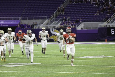 Elk River running back Jon Suchy sprints away from the Apple Valley defense.