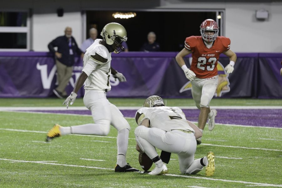Sophomore kicker Bilhal Kone lines up for an extra point.