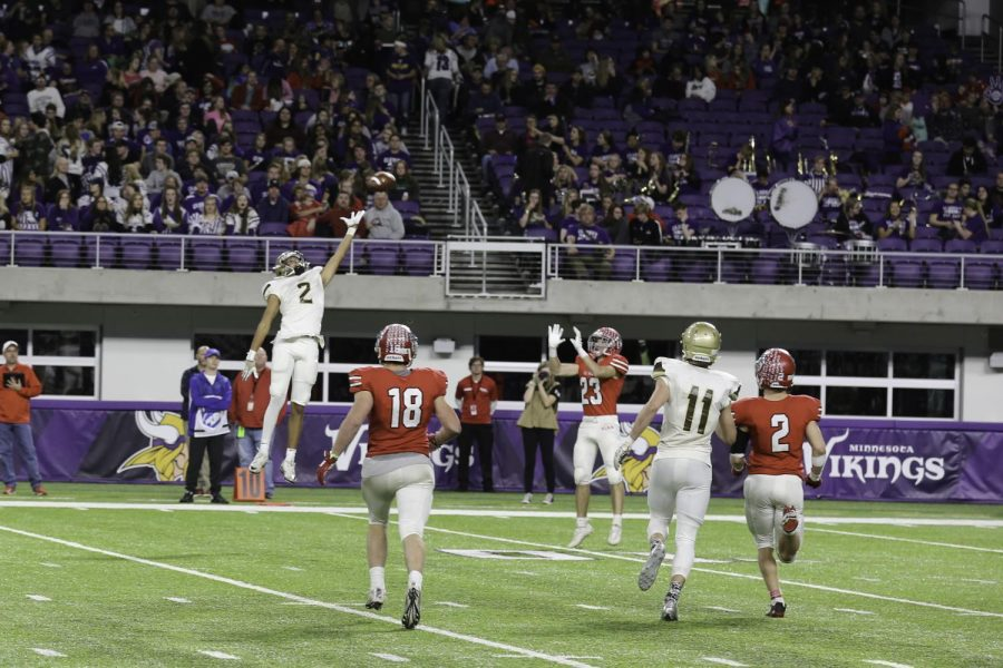 Senior wideout Nathan Macho tips a pass, leading to an interception.